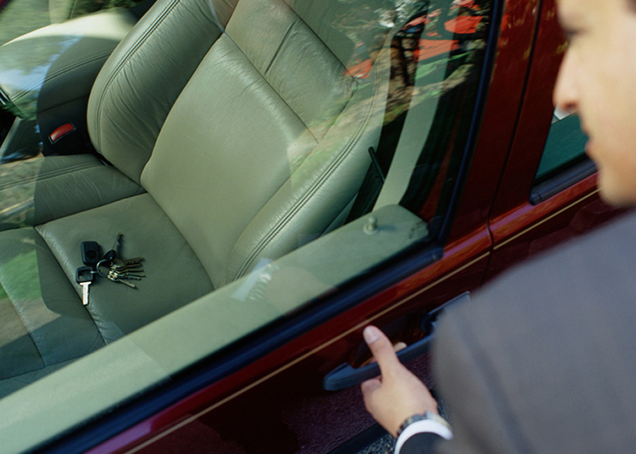 Businessman Looking at His Keys Locked in the Car